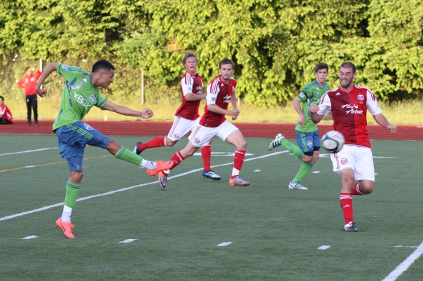 Sounders U-23's Jamael Cox hits a shot that proved to be the game winner.