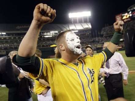 Stephen Vogt celebrates - AP Photo/Marcio Jose Sanchez