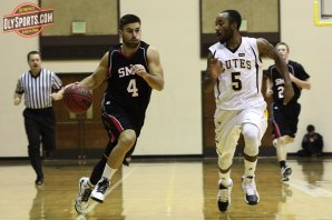 Evan Coulter drives on Terrell Williams