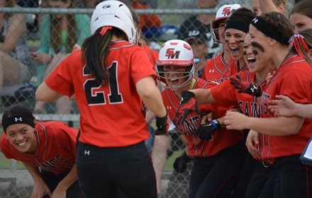 Saints celebrate their walk-off win - Photo via SMUSaints.com